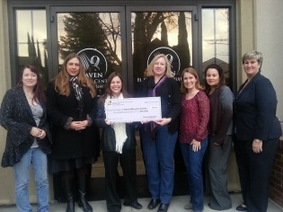 Northern California Women's Music Festival presents check to Haven Women's Center